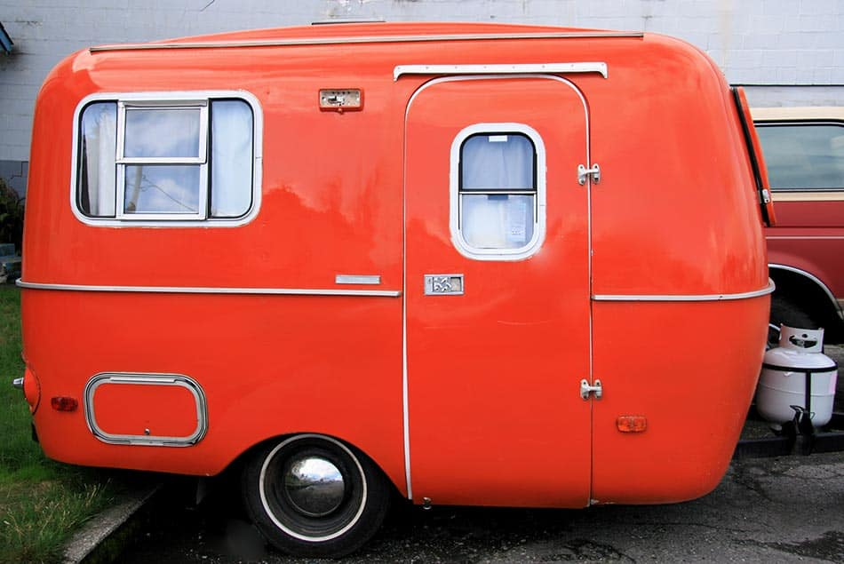 Small red travel trailer