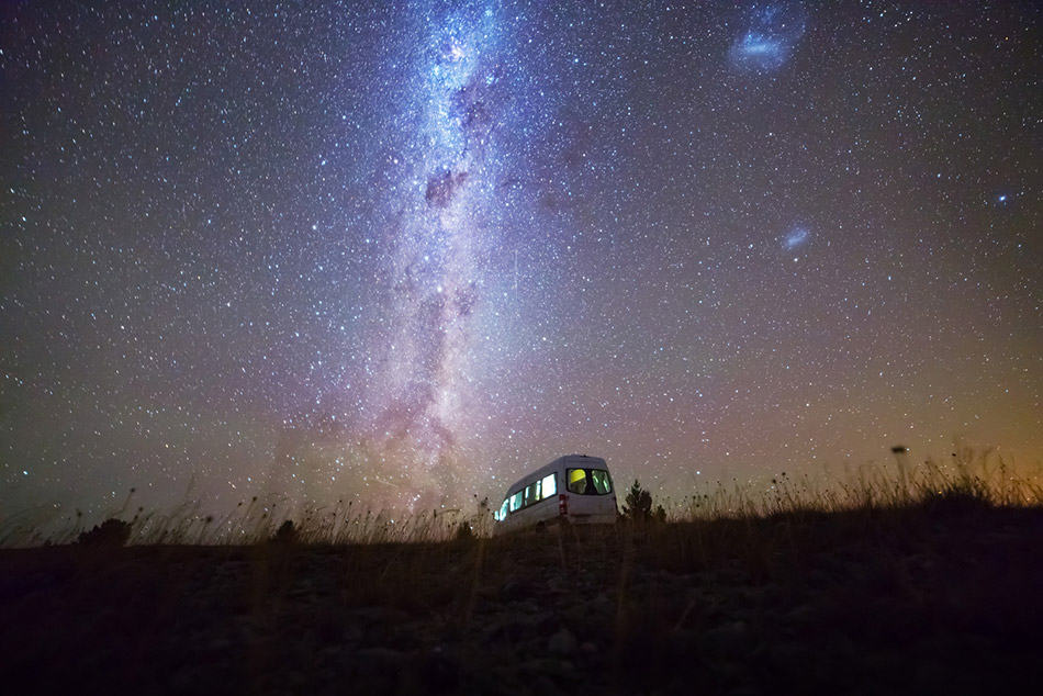 Camper van parked with night sky