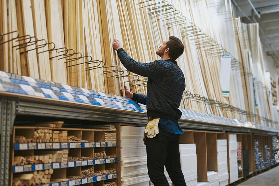 Man buying wood at home improvement store