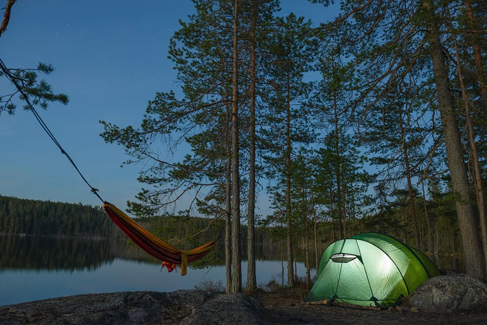Tent and hammock beside lake