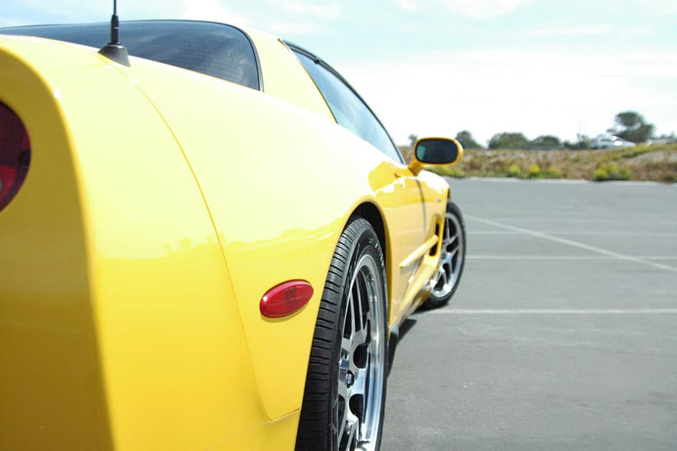 Yellow corvette parked in parking lot