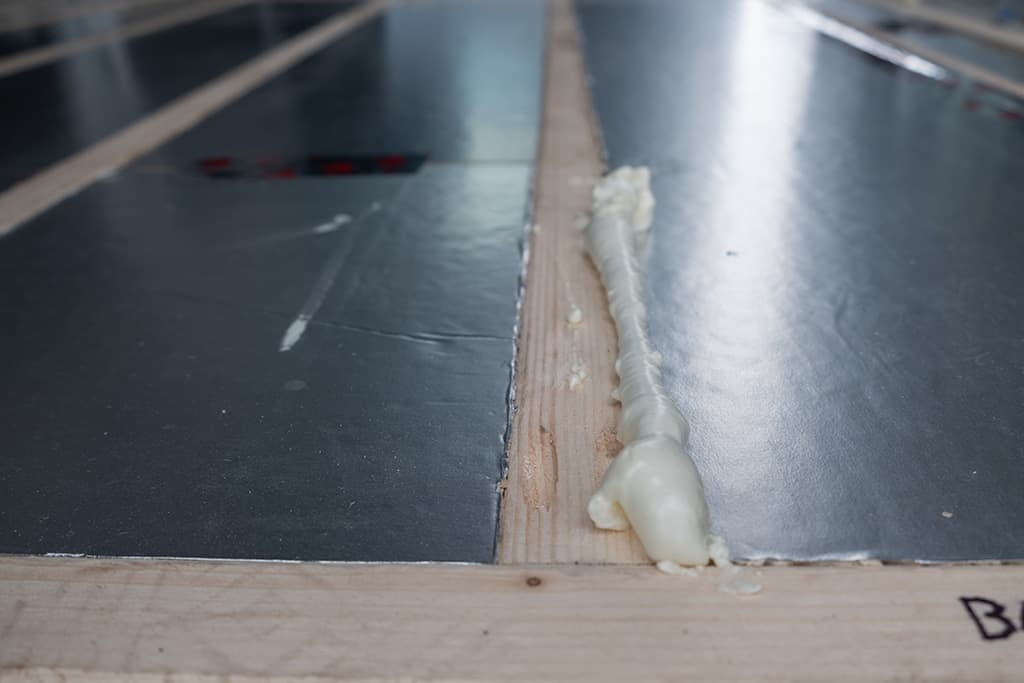 Close up of great stuff installed in floor crack