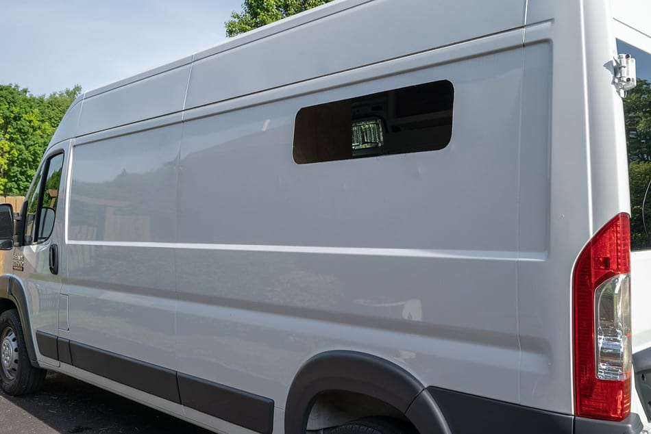 Van conversion with window hole cut in side