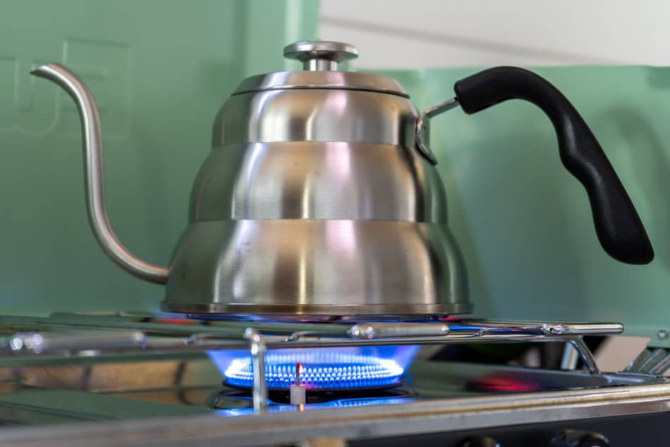 Kettle on stove with flame