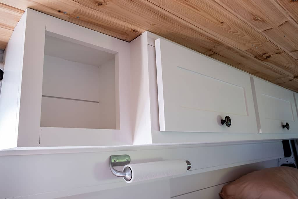 Full view of overhead cabinets and kitchen shelf