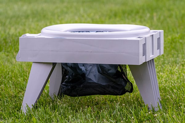 Portable toilet in grass