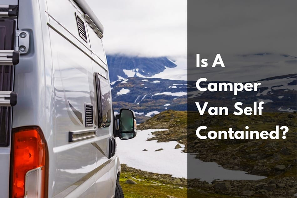 View of a camper van with a mountain view