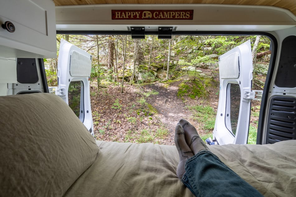 View from camper van bed looking out the back