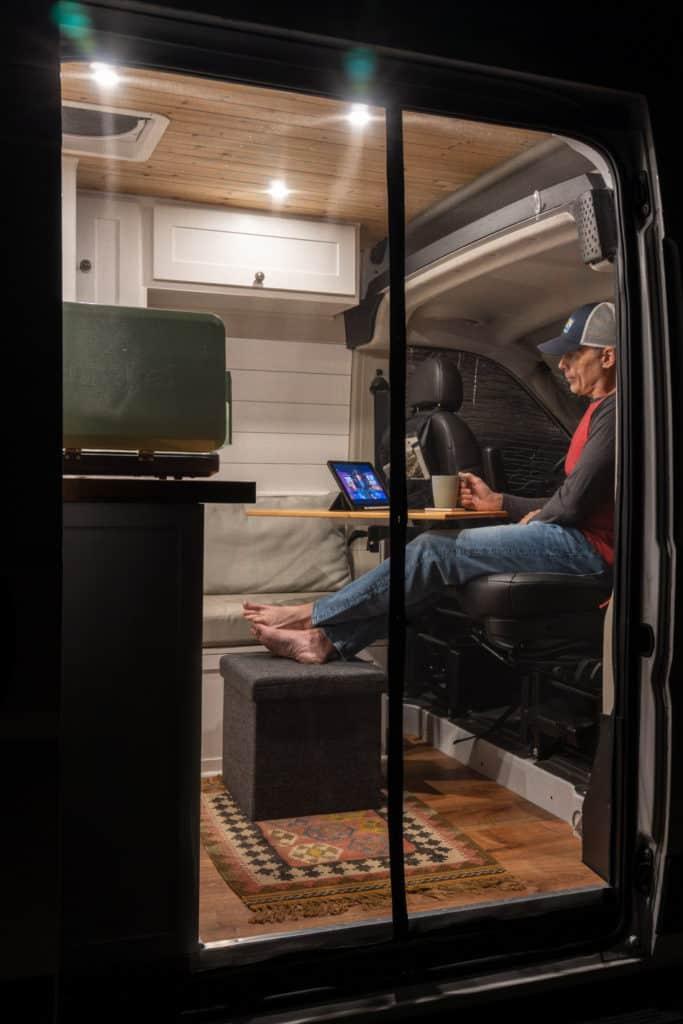 Sitting in camper van watching TV