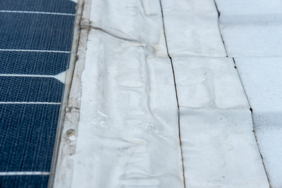 Closeup of solar panels taped to roof
