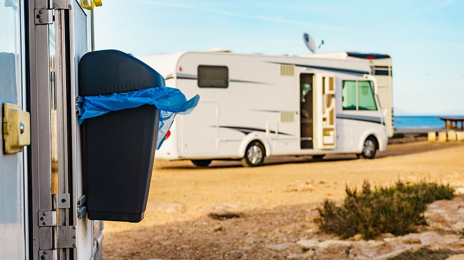 trash can hanging on side of RV