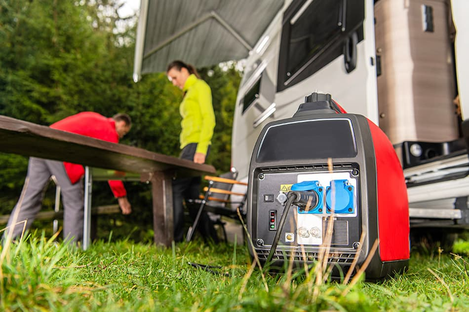 Couple using a generator while camping in their RV